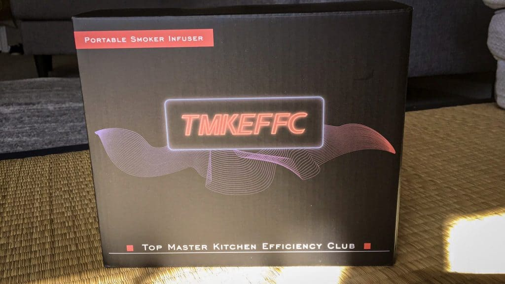 Picture of the box of the TMKEFFC Smoking Gun, black and with a glowing logo of the brand.