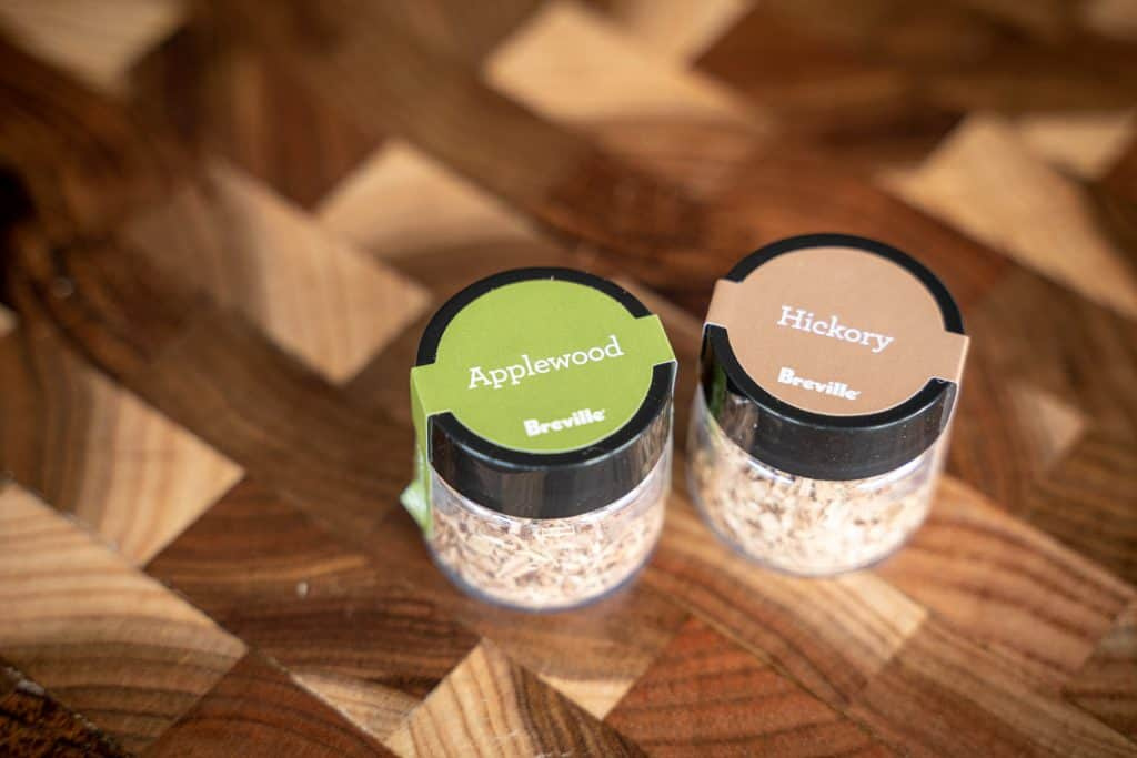 Close-up shot of two wood chip containers, labeled Applewood and Hickory.