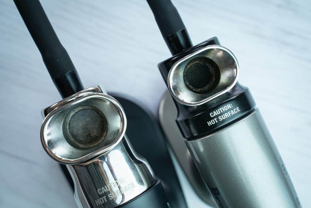 Top view showing the difference in the size of the burn chamber between the PolyScience smoking gun and the Breville smoking gun, showing how the PolyScience has a bigger chamber.